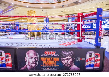 LAS VEGAS - APR 28 : Boxing ring at the MGM hotel lobby advertises about the Floyd Mayweather and Manny Pacquiao fight on April 28 2015 in Las Vegas , the fight scheduled to May 2 2015 - stock photo