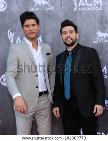 LAS VEGAS - APR 6:  Dan Smyers, Shay Mooney, Dan & Shay at the 2014 Academy of Country Music Awards - Arrivals at MGM Grand Garden Arena on April 6, 2014 in Las Vegas, NV - stock photo