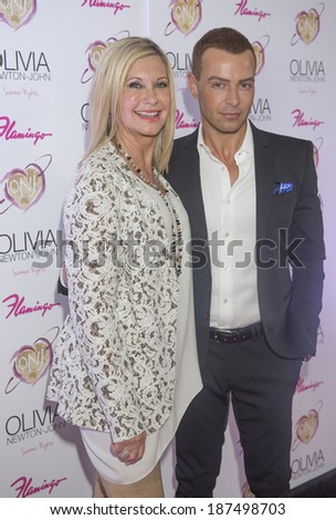 LAS VEGAS, - APRIL 11: Entertainer Olivia Newton-John (L) and actor Joey Lawrence attends the grand opening of her residency show 'Summer Nights' at Flamingo Las Vegas on April 11, 2014 - stock photo