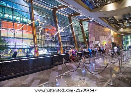LAS VEGAS - AUG 14 : The lobby of Aria Resort and Casino in Las Vegas on August 14 2014. The Aria was opened on 2009 and is the world's largest hotel to receive LEED Gold certification - stock photo