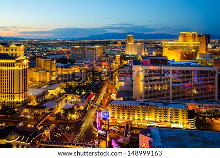 LAS VEGAS - AUGUST 14: An aerial view of Las Vegas Strip on August 14, 2012 in Las Vegas, Nevada. The strip is approximately 4.2 mi (6.8 km) long and featured with world class hotels and casinos.  - stock photo