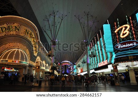 LAS VEGAS - CIRCA MAY 2012: Fremont Street experience in Las Vegas, Nevada. The street is the second most famous street in the Las Vegas. Fremont Street dates back to 1905, when Las Vegas was founded. - stock photo