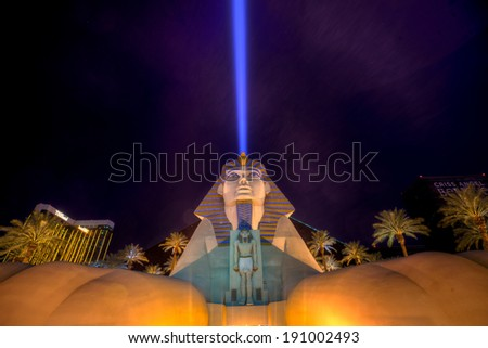 LAS VEGAS - DEC 13: Luxor Las Vegas on December 13, 2011 in Las Vegas. Luxor opened in 1993 and contains a replica of the Great Sphinx of Giza and a pyramid shaped building with a spotlight. - stock photo
