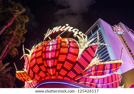 LAS VEGAS - DEC 13 : The Flamingo hotel and casino sign on December 13 2012 in Las Vegas. Las Vegas in 2012 is projected to break the all-time visitor volume record of 39-plus million visitors - stock photo