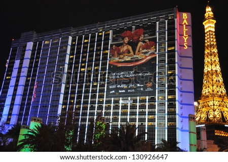 LAS VEGAS - DECEMBER 2: Bally's Las Vegas and Paris Eiffel Tower Replica on December 2, 2012 in Las Vegas. Bally's is located on the Strip and has over 2,800 rooms available for guests. - stock photo