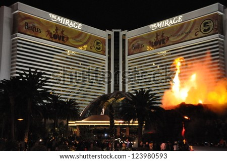 """LAS VEGAS - DECEMBER 5: Mirage Hotel and Casino on December 5, 2012 on the Strip in Las Vegas, Nevada. An artificial volcano along the Strip that """"erupts"""" nightly from 8 pm�midnight on the hour. - stock photo"""