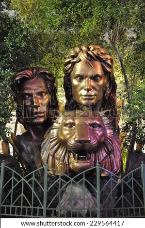 LAS VEGAS - DECEMBER 4: Siegfried & Roy bronze statue at the Mirage on December 4, 2012 in Las Vegas, Nevada. The Mirage is a 3,044 room Polynesian-themed hotel and casino resort. - stock photo