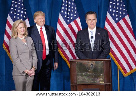 LAS VEGAS - FEB 2: Mitt Romney (R) speaks as Donald Trump and Romney's wife, Ann Romney, watch at the Trump Hotel on February 2, 2012 in Las Vegas, Nevada. Trump is endorsing Romney for president. - stock photo