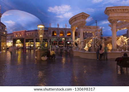 LAS VEGAS - FEBRUARY 22:A view of trevvi fountain at the forum shops in Las Vegas on February 22, 2013. The forum shops feature a large aquarium and statues that come to life. - stock photo