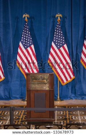 LAS VEGAS - FEBRUARY 02: Empty podium at the Trump International Hotel where Donald Trump would endorse Presidential Candidate Mitt Romney for President, February 02, 2012 in Las Vegas, NV - stock photo