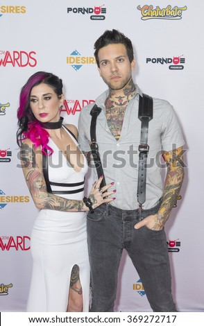 LAS VEGAS - JAN 23 : Adult film actress Joanna Angel (L) and adult film actor Small Hands attend the 2016 Adult Video News Awards at the Hard Rock Hotel on January 23, 2016 in Las Vegas, Nevada.   - stock photo