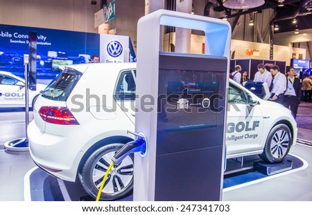 LAS VEGAS - JAN 09 : The Volkswagen E-Golf electric car at the CES Show in Las Vegas, Navada, on January 09, 2015. CES is the world's leading consumer-electronics show. - stock photo