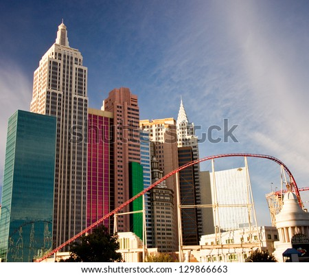 LAS VEGAS - JANUARY 7: A roller coaster soars past the replica Chrysler building at the New York, New York resort hotel in Las Vegas, Nevada on January 7, 2013. - stock photo