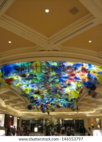 LAS VEGAS - JULY 9: Ceiling of the Bellagio in Las Vegas, on July 9, 2013. Dale Chihuly's Fiori di Como, composed of over 2,000 hand-blown glass flowers, covers 2,000 sq ft of the lobby ceiling. - stock photo