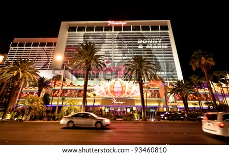LAS VEGAS - JULY 13: The Flamingo Hotel on July 13, 2011 in Las Vegas, Nevada. The Flamingo, the oldest operating hotel on the Strip, offers a 77,000 sq ft casino along with 3,626 hotel rooms. - stock photo