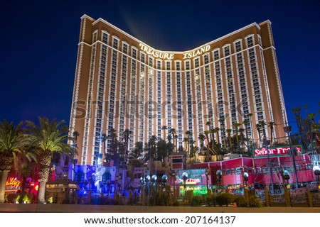 LAS VEGAS - JULY 21 : Treasure Island hotel and casino on July 21 2014 in Las Vegas.  This Caribbean themed resort has an hotel with 2,884 rooms. - stock photo