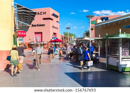 LAS VEGAS - JULY 27: Unidentified people shop at Premium Outlet on July 27, 2013 in Las Vegas. Premium Outlet are located across the United States and offer discounts and special promotions  - stock photo