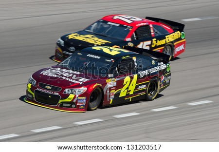 LAS VEGAS - MAR 10: Jeff Gordon in front of Clint Bowyer at the Nascar Kobalt 400 in Las Vegas, NV on Mar 10, 2013 - stock photo