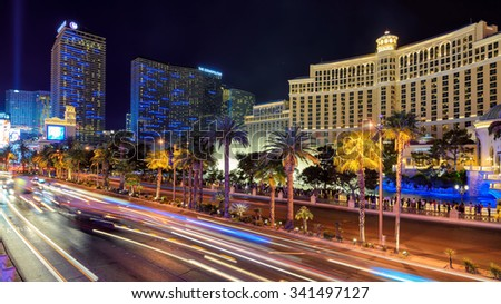 LAS VEGAS - MARCH 26 : World famous Vegas Strip on March 26 , 2015 in Las Vegas. Fountains of Bellagio hotel  and the Las Vegas Strip  - stock photo