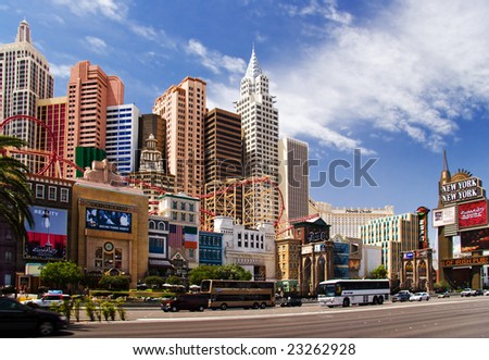LAS VEGAS – MAY 2: Automobiles and tourist buses travel past the New York, New York Hotel & Casino on May 2, 2007 in Las Vegas. The hotel skyline architecture simulates the real New York City skyline. - stock photo
