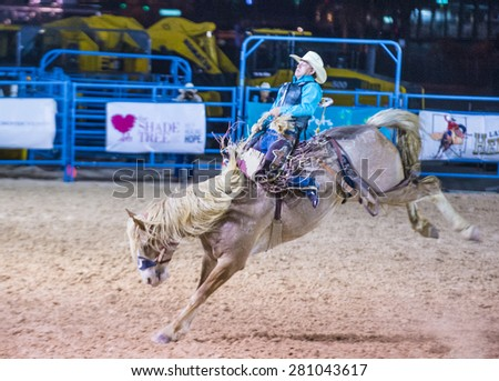 LAS VEGAS - MAY 16 : Cowboy Participating in a Bucking Horse Competition at the Helldorado days Rodeo , A Professional Rodeo held in Las Vegas on May 16 2015 - stock photo