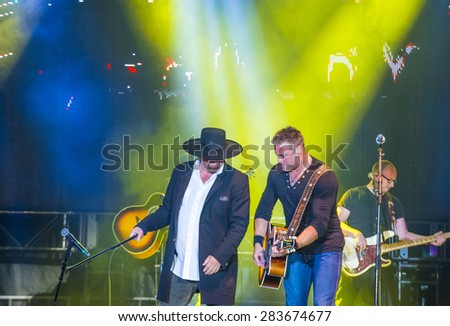 LAS VEGAS - MAY 22 : Eddie Montgomery and Troy Gentry of Montgomery Gentry perform onstage during the Cowboy Spring Break held in the MGM Village in Las Vegas on May 22 , 2015 - stock photo