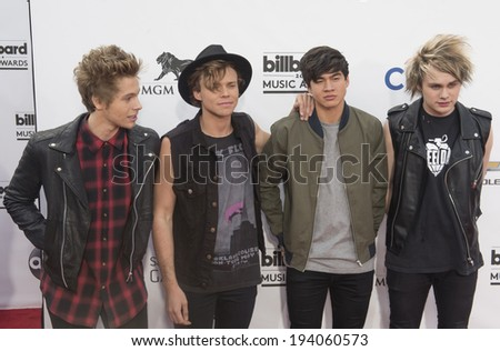 LAS VEGAS - MAY 18 : Members of the pop band 5 Seconds of Summer attend the 2014 Billboard Music Awards at the MGM Grand Garden Arena on May 18 , 2014 in Las Vegas. - stock photo