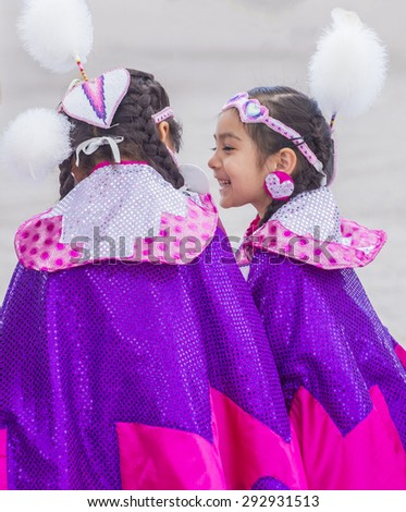 LAS VEGAS - MAY 24 : Native American girls take part at the 26th Annual Paiute Tribe Pow Wow on May 24 , 2015 in Las Vegas Nevada. Pow wow is native American cultural gathernig event. - stock photo