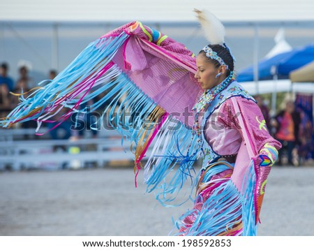 LAS VEGAS - MAY 24 : Native American woman takes part at the 25th Annual Paiute Tribe Pow Wow on May 24 , 2014 in Las Vegas Nevada. Pow wow is native American cultural gathernig event. - stock photo