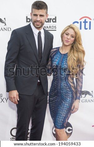 LAS VEGAS - MAY 18 : Soccer player Gerard Pique (L) and recording artist Shakira attend the 2014 Billboard Music Awards at the MGM Grand Garden Arena on May 18 , 2014 in Las Vegas. - stock photo