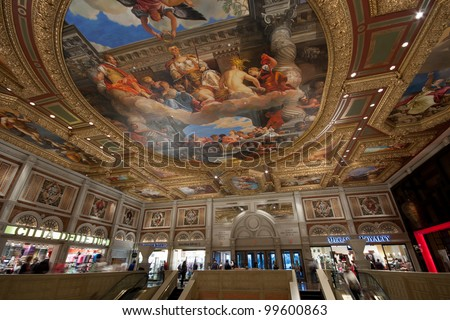 LAS VEGAS, NEVADA - APRIL 11, 2011: Entry to Venetian hotel with ceiling painting mimic ancient pictures in Las Vegas on April 11, 2011. The resort opened in 1999 and built at a cost of $1.5 billion - stock photo