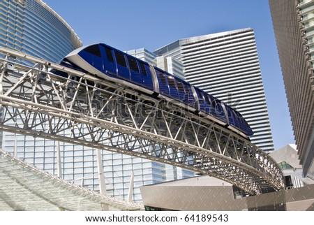 LAS VEGAS, NEVADA- CIRCA DEC. 2009: A monorail tram passes through an ultra modern cityscape at CityCenter in Las Vegas, circa Dec. 2009, America's largest privately-financed complex - stock photo