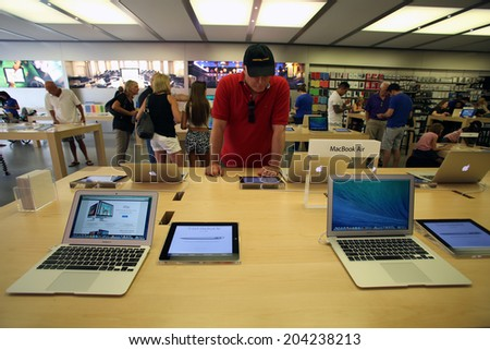LAS VEGAS, NEVADA - FRI. JUNE 27, 2014:  People  shop at an Apple Computers retails store in Las Vegas, Nevada, on Friday, June, 27, 2014.  - stock photo