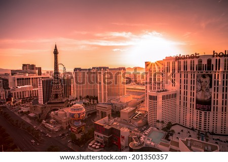LAS VEGAS, NEVADA - MAY 7, 2014: Desert sunrise over Las Vegas Strip hotel resorts and casinos. Over 39.7 million people visit Las Vegas each year. - stock photo