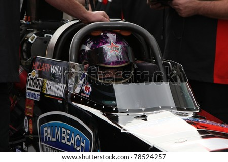 LAS VEGAS NEVADA - MAY 12: Hillary Will, in her top fuel dragster, a few minutes before start to the NHRA drag racing finals on May 12, 2008 in Las Vegas Nevada. - stock photo