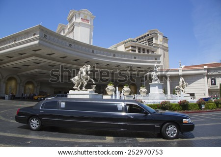 LAS VEGAS, NEVADA - MAY 9, 2014: Stretch limousine in the front of Caesars Hotel and Casino. The first stretch limousine was created in Fort Smith, AR around 1928 by a coach company named Armbruster - stock photo