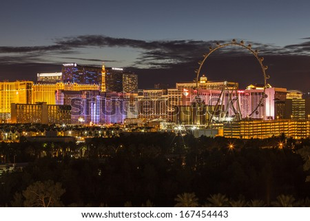 LAS VEGAS, NEVADA - November 28:  Dusk view of brightly lit resorts on the strip. Vegas has 149,820 hotel rooms with a average daily rate of $115 on November 28, 2013 in Las Vegas, Nevada.  - stock photo