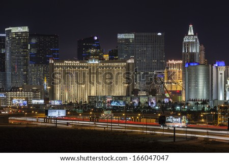 LAS VEGAS, NEVADA - November 29:  Interstate 15 traffic and resorts on the strip.  Vegas has 149,820 hotel rooms with a average daily rate of $115 on November 29, 2013 in Las Vegas, Nevada.  - stock photo
