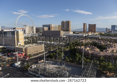 LAS VEGAS, NEVADA, USA - June 10, 2015:  Clear desert morning view of resort casino towers and the High Roller ferris wheel attraction.   - stock photo