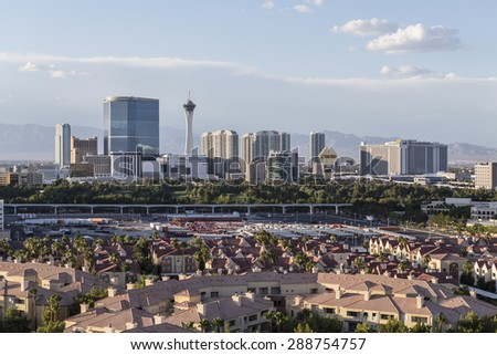 LAS VEGAS, NEVADA, USA - June 10, 2015:  Sunny afternoon sky above condo complexes and the Stratosphere and Fontainebleau towers on the Las Vegas Strip. - stock photo