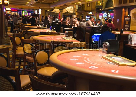 LAS VEGAS, NEVADA, USA - OCTOBER 23, 2013 : Gaming tables in the lobby of casino Treasure Island, Las Vegas. This Caribbean themed resort has an hotel with 2,884 rooms, and located on Las Vegas Strip  - stock photo