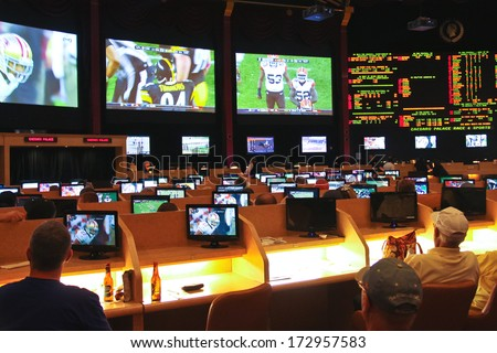LAS VEGAS, NEVADA, USA - OCTOBER 20, 2013 : Sport betting at Caesar's Palace   in Las Vegas, Caesar's Palace hotel opened in 1966 and has a Roman Empire theme. - stock photo