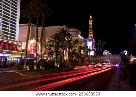 Las Vegas, Nevada, USA - Sept. 25, 2014: Nightlife along the famous Las Vegas Strip in front of the Paris Casino in Las Vegas, Nevada, USA in Sept. 25, 2014  - stock photo
