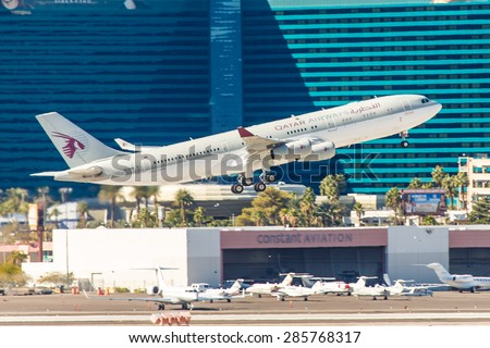 LAS VEGAS - NOVEMBER 3: Airbus A340 Qatar Airways takes off from McCarran Airport in Las Vegas, NV on November 3, 2014. Qatar Airways was named Airline of Year 2012 at Skytrax World Airline Awards. - stock photo