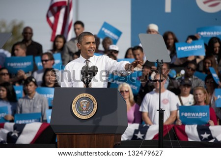 LAS VEGAS - NOVEMBER 01: Barack Obama speaks at a 2012 Election Campaign rally with supporters in the background at Cheyenne Sports Complex on November 01, 2012 in North Las Vegas, Nevada - stock photo