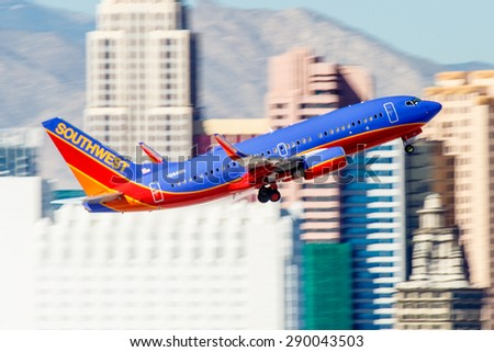 LAS VEGAS - NOVEMBER 7: Boeing 737 Southwest Airlines takes off from McCarran in Las Vegas, NV, USA on November 7, 2014. Southwest is a major US airline and the world's largest low-cost carrier. - stock photo