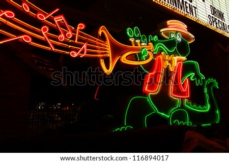 LAS VEGAS - NOVEMBER 30: The Orleans Hotel and Casino Alligator Sign on November 30, 2011 in Las Vegas.  The Orleans has a Mardi Gras theme and was opened in the year 1996. - stock photo
