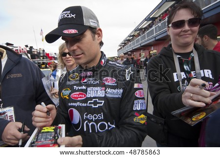 LAS VEGAS, NV - FEB 28: Jeff Gordon signs autographs before the running of the Shelby American GT 350 NASCAR Sprint Cup race at the Las Vegas Motor Speedway on Feb 20 2010  in Las Vegas, NV - stock photo