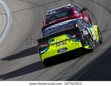 Las Vegas , NV - Mar 09, 2014:  Carl Edwards (99) battles for position during the Kobalt Tools 400 race at the Las Vegas Motor Speedway  in Las Vegas , NV. - stock photo