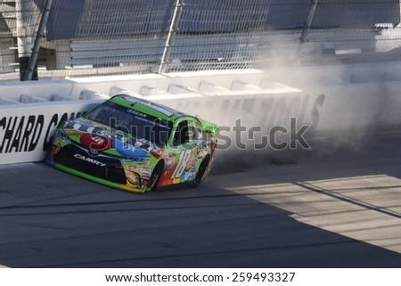 Las Vegas, NV - Mar 07, 2015:  David Ragan (18) hits the wall and damages his M&M's Toyota during the the Kobalt 400 at Las Vegas Motor Speedway in Las Vegas, NV.  - stock photo